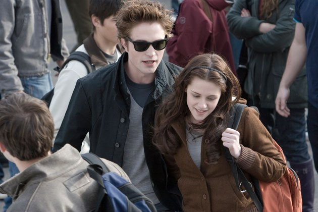 Twilight Sexiest Moments: We love Robert Pattinson in his Raybans here as Edward and Bella hang out together at school.