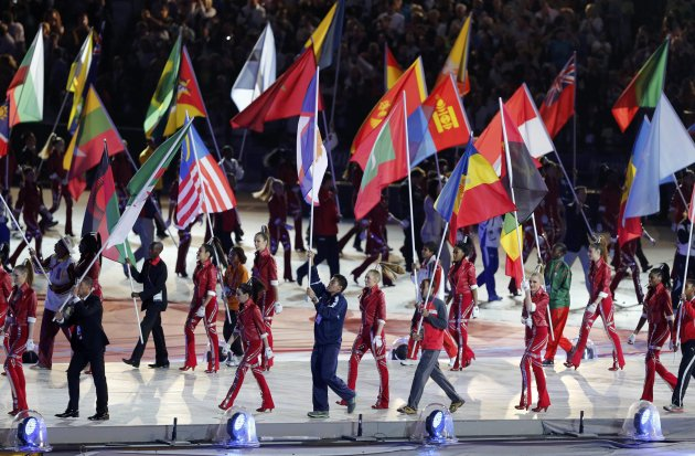Flagbearers take part in the athletes' march during the closing ceremony of the London 2012 Olympic Games at the Olympic Stadium