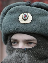 An Interior Ministry soldier looks on as guards during a protest rally in Moscow, Russia, Sunday, Jan. 13, 2013. Some thousands of people are gathering in central Moscow for a protest against Russia's new law banning Americans from adopting Russian children as temperatures drop to - 14 C ( 6,8 Fahrenheit) in Moscow. (AP Photo/Mikhail Metzel)