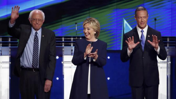 Democratic presidential candidates Sanders, Clinton and O'Malley react to the crowd before the start of the first official Democratic candidates debate of the 2016 presidential campaign in Las Vegas