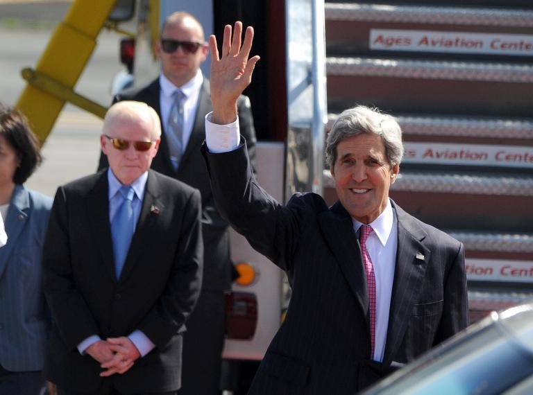 US Secretary of State John Kerry arrives at Manila International Airport on December 17, 2013