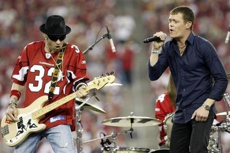 "Arnold and Harrell of the rock band ""3 Doors Down"" perform at halftime during NFL Wild-Card Round playoff football game in Glendale"