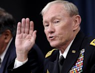 In this photo taken, Thursday, May 10, 2012, Joint Chiefs Chairman Gen. Martin E. Dempsey speaks during a briefing at the Pentagon. A course for U.S. military officers was teaching that America is at war with Muslims, suggesting the U.S. ultimately may have to wipe out Islamic holy cities like Mecca and Medina just as it destroyed Hiroshima in World War II. That teaching is counter to repeated assertions by U.S. officials over the last decade that the U.S. is at war against terrorists who distort Islam _ not against the religion itself. The Defense Department suspended the course at the Joint Forces Staff College last month due to the inflammatory materials, but details of what was taught were first revealed Thursday. Dempsey called the material objectionable, irresponsible and against American values on freedom of religion. (AP Photo/Susan Walsh)
