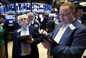 Traders work on the floor of the New York Stock Ex…