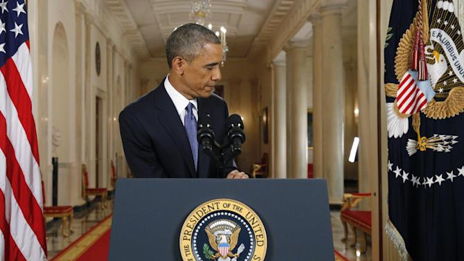 "President Barack Obama leaves the podium after speaking during a nationally televised address from the White House in Washington, Thursday, Nov. 20, 2014. Spurning furious Republicans, President Barack Obama unveiled expansive executive actions on immigration Thursday night to spare nearly 5 million people in the U.S. illegally from deportation and refocus enforcement efforts on ""felons, not families.""  (AP Photo/Jim Bourg, Pool)"