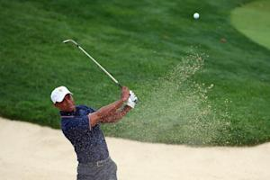 Tiger Woods of USA hits his second shot on the 4th …