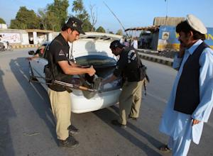 Pakistani policemen search a vehicle in Bannu, a town…