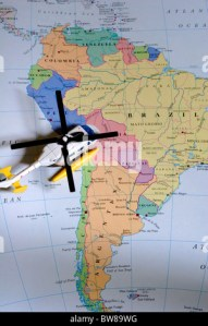 map of south american countries on isolated over white map of globe     Toy helicopter on map of South America   Stock Photo