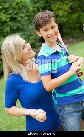 Download Mother and son playing baseball in yard Stock Photo - Alamy