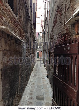 Narrow and empty alley or pedestrian street at the ...