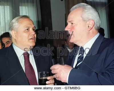 Yugoslav President Slobodan Milosevic (R) chats with ...