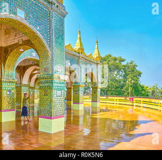 MANDALAY, MYANMAR - FEBRUARY 23, 2018: The arched gallery ...