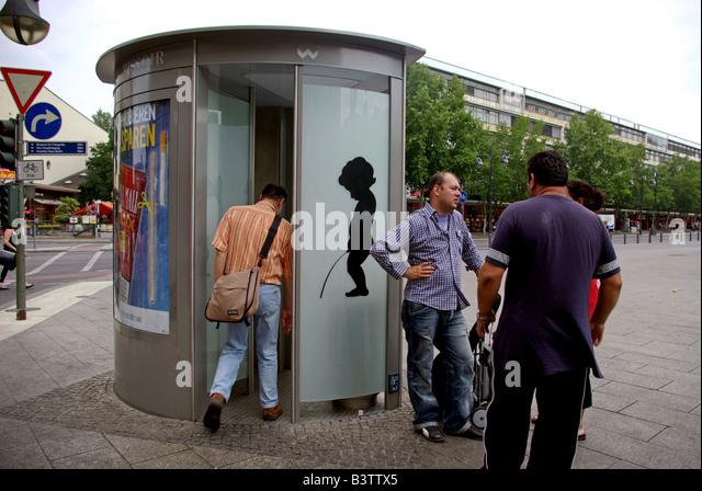 public bathroom entering stock photos & public bathroom entering