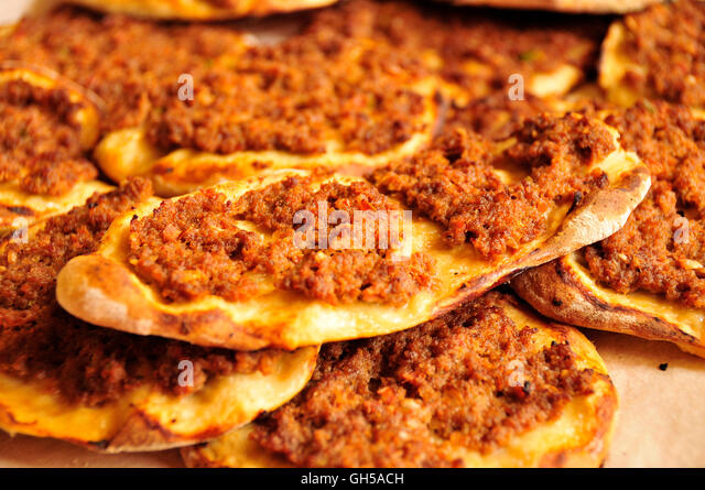 arab pizza with minced lamb paprika and tomato in a restaurant beirut stock