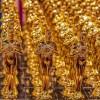 fila de estatuillas de los premios Oscar