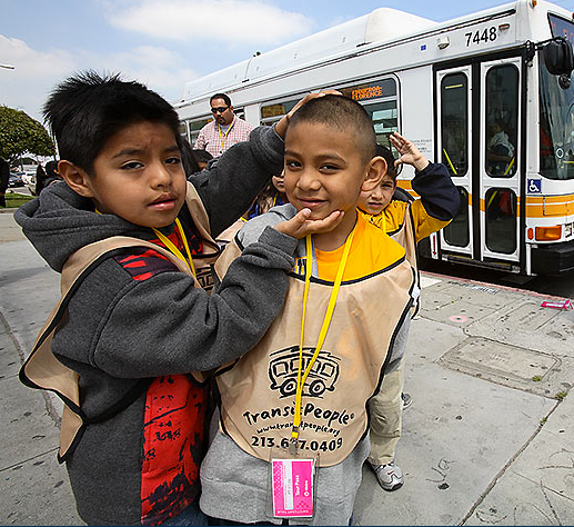 """One child helping another to smile seems like one of the easier challenges teachers could face on a """"free transit field trip.""""  Photo: ##http://www.transitpeople.org/photo.shtml##Tim Adams/Transit People##"""
