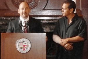 LoGrande, with a wounded Villaraigosa, at the July announcement of his appointment.  Photo: ##http://www.archpaper.com/e-board_rev.asp?News_ID=4742##The Architechts Newspaper##