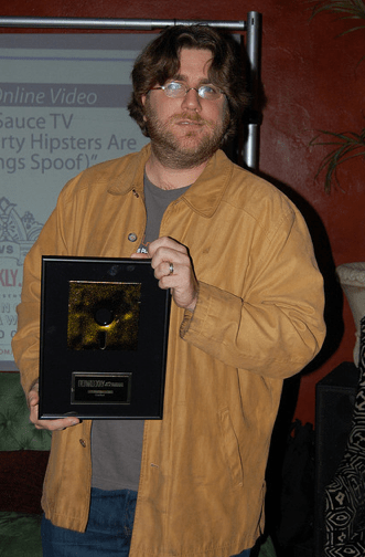 "Me with the ""2009 Activist Website of the Year"" Award from L.A. Weekly."