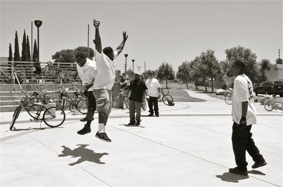 Brothers Bryan August-Jones and John Jones III (ESRBC members) jump for joy at the Watts Towers. Sahra Sulaiman/Streetsblog L.A.