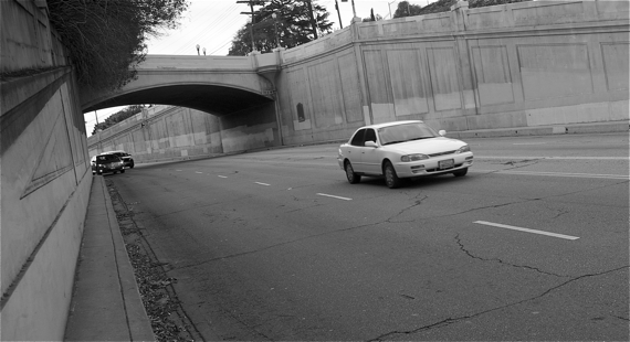 The car at top left was one of several that hugged the curb as they came flying around the curve under Waverly (heading into Atwater). I would have stood closer to the curve so that you could better see the remains of several hubcaps in the gutter, but it felt too dangerous. Sahra Sulaiman/LA Streetsblog