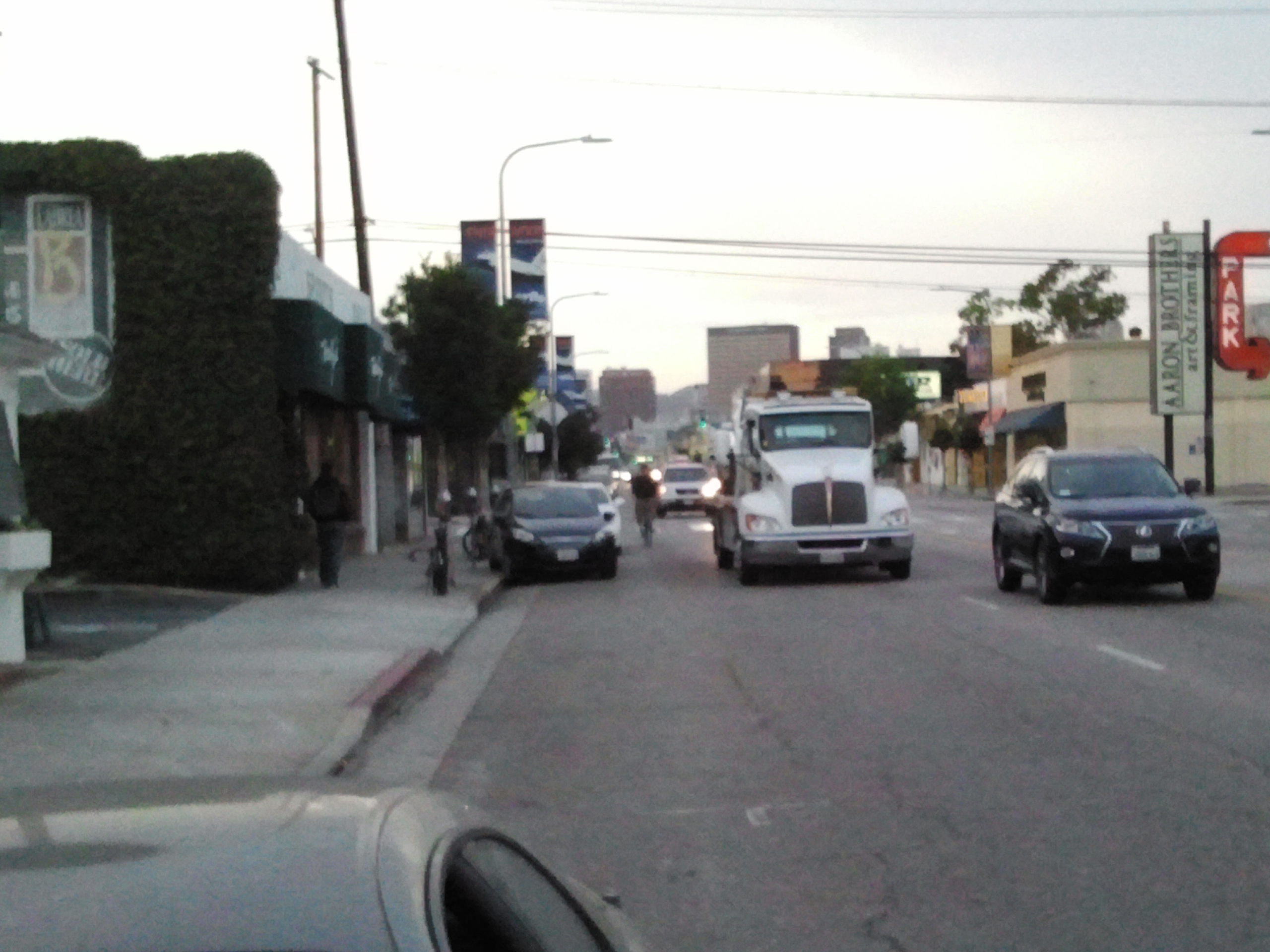 Large truck just squeezed past cyclist in same lane; that couldn't have felt very comfortable.