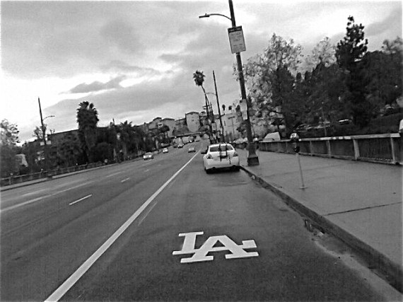 """LA"" marks the spot in the peak-hour bus-only lane. Sahra Sulaiman/LA Streetsblog"