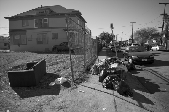Fetid garbage bags line the sidewalk in January, making that stretch nearly impassable. Sahra Sulaiman/LA Streetsblog