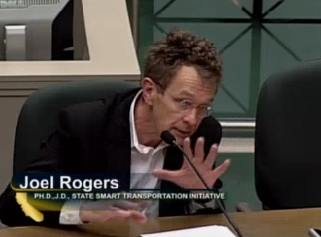 Professor Joel Rogers emphasizes a point to the Assembly Transportation Committee