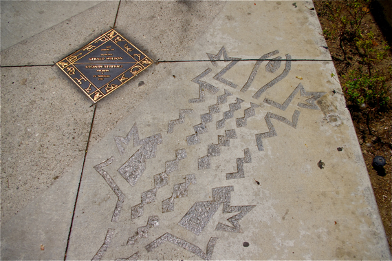 The Sankofa Passage along Degnan St. is adorned with the names of important African-American artists. Their names are surrounded by symbols used to brand slaves. Sahra Sulaiman/LA Streetsblog
