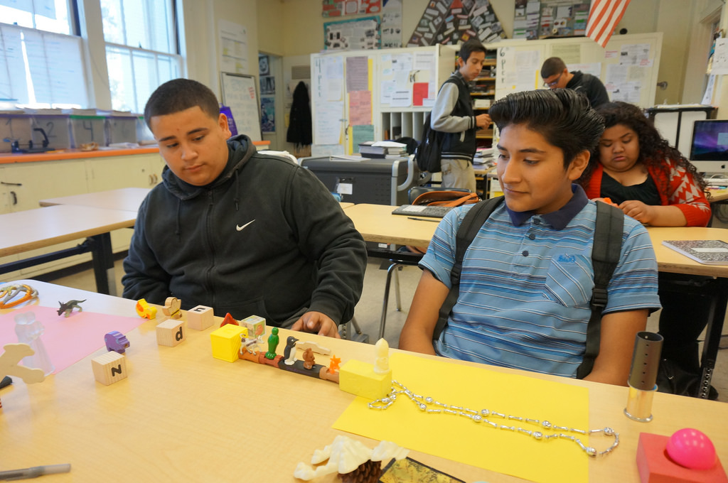 Alex Chupina, left, and Javier Cortez work on their model of a re-envisioned Metro Goldline that offers free rides to passangers