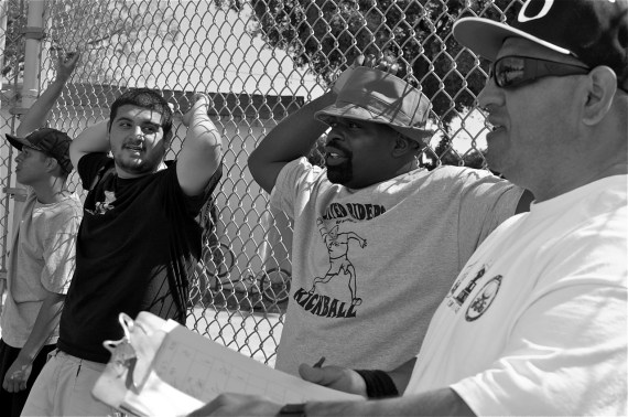 John Jones III (center) and JP Partida (right) oversee the game in progress.