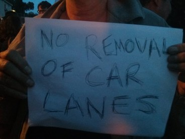 Attendee at the meeting making it clear they don't want bike lanes on Figueroa. Photo by Erick Huerta