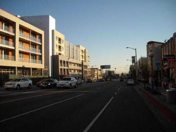La Brea Avenue southbound. just south of Fountain Avenue: Thanks to the new mixed-use project,  the street looks more inviting. However, center-median is barely  visible, and sidewalks have not been  widened by the City of WeHo.