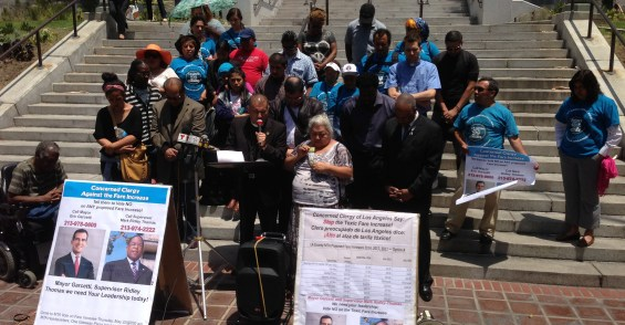 Bishop Juan Carlos Mendez, of Churches for Action, prays for Metro board officials to  have hearts of compassion in opposition to Metro's proposed fare increase. Photo: Joe Linton/Streetsblog LA