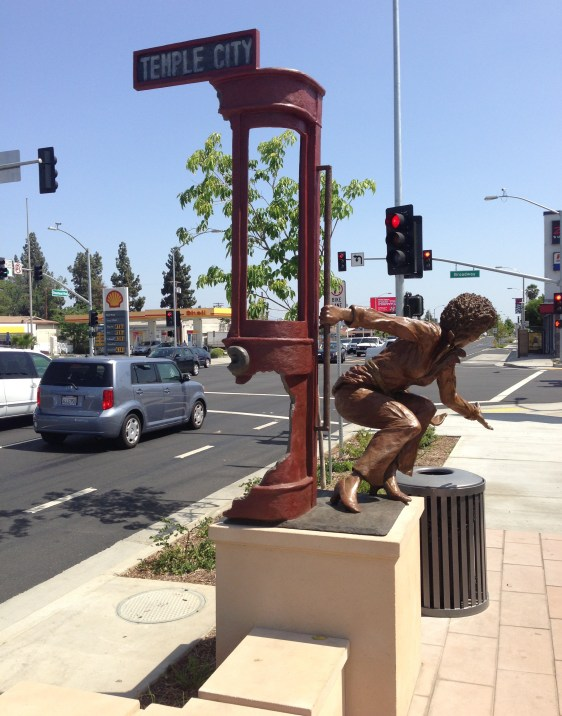 Temple City's Rosemead Blvd Project includes this sculpture of a woman riding a streetcar.