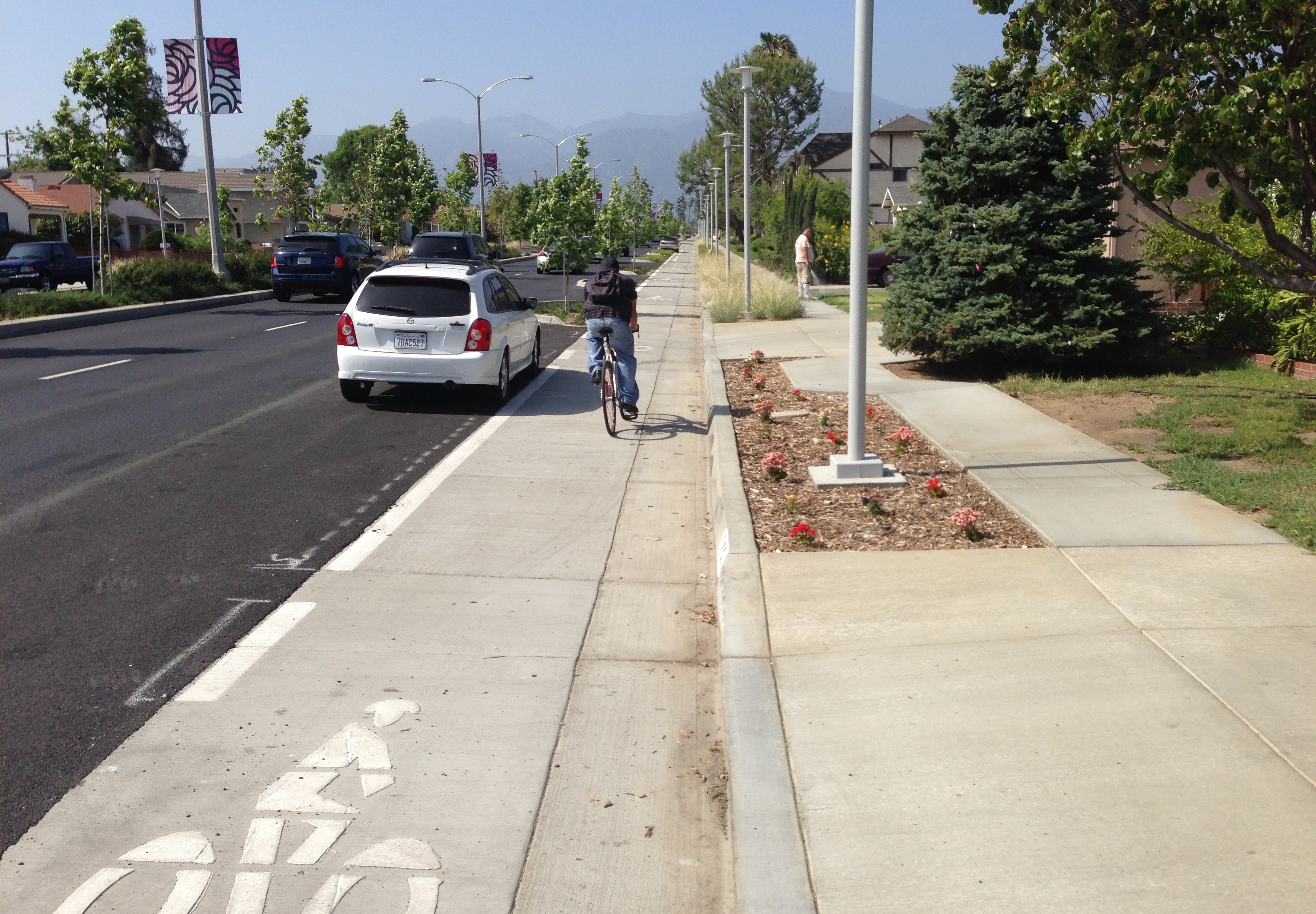Another shot of the driveway stencil and the parking-protected bikeway.