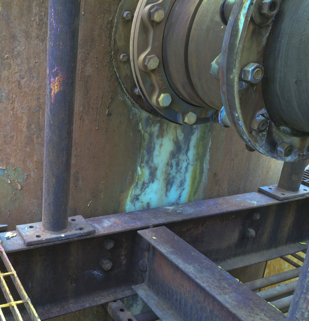 April 18, 2014 -- Leaking gasket at reaction tank - acidic waste has removed the protective coating. (Source: DTSC)