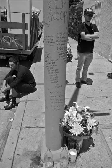 Friends and supporters leave messages on a light pole near the site where Toledo was killed. Sahra Sulaiman/Streetsblog LA