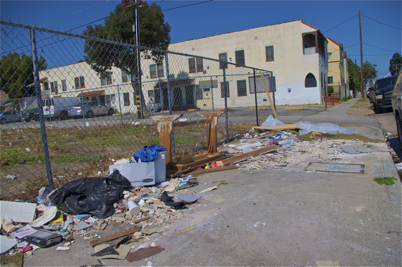 The lot at 43rd and Vermont accumulates trash. Sahra Sulaiman/Streetsblog LA