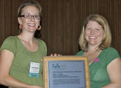 Seleta Reynolds (right) then serving as President of the Association of Pedestrian and Bicycle Professionals (APBP) giving a 2010 award to Leslie Meehan of Nashville. Photo: APBP