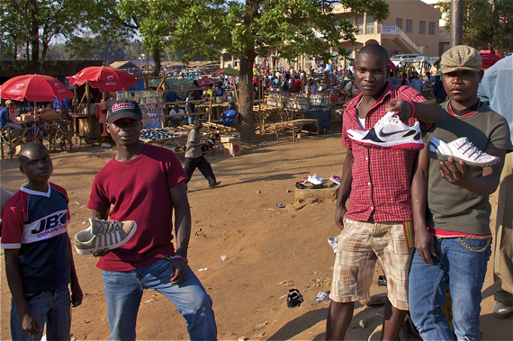 Guys wash used shoes off in the river (to the left, out of frame) and sell them in the main market in Lilongwe. Sahra Sulaiman/Streetsblog LA