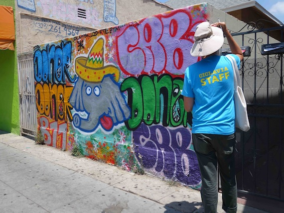 CicLAvia volunteers conduct outreach along Cesar Chavez Ave. in Boyle Heights. Erick Huerta/Streetsblog LA