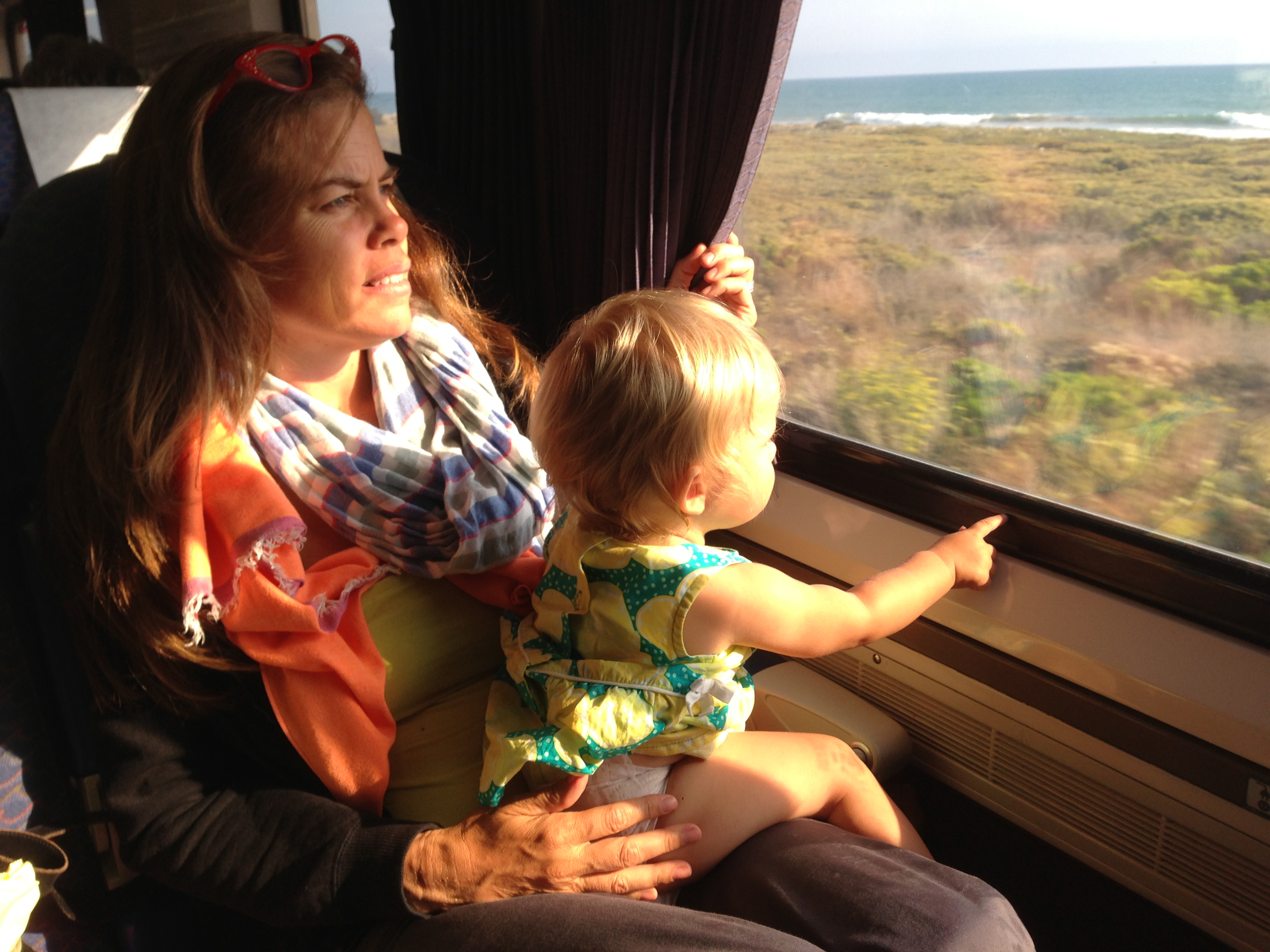 Joe's one-year-old daughter Maeve sitting on her mom's lap on the Amtrak Surfliner last weekend. Photo: Joe Linton/Streetsblog L.A.