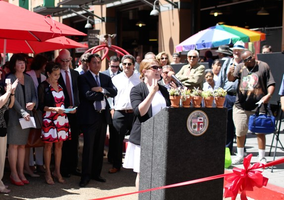 "Seleta Reynolds speaks at the ribbon cutting for the ""Dressed Rehearsal"" on Broadway. Photo: LADOT"