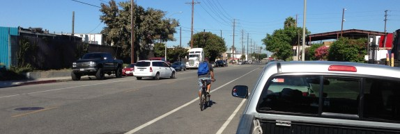 Cyclist riding the G Street bike lanes in Wilmington
