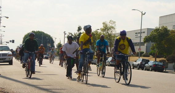 Tafarai Bayne and Andres Ramirez Huiztek sport yellow CicLAvia South L.A. shirts as they lead a group ride up Central Ave. to promote bike lanes. Sahra Sulaiman/Streetsblog L.A.