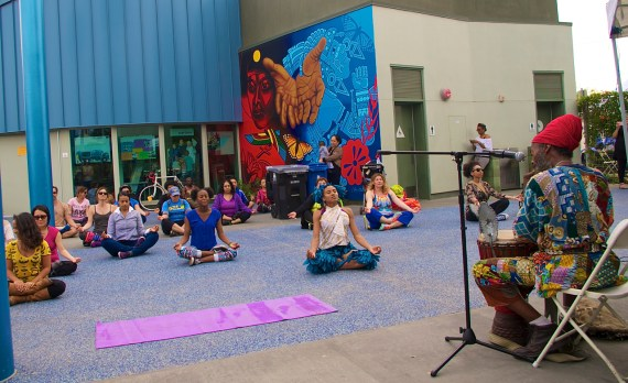 An African dance workshop by the Anani Cultural Center at the CD 9 Constituent Center begins with some yoga stretches and a calming flute melody. Sahra Sulaiman/Streetsblog L.A.