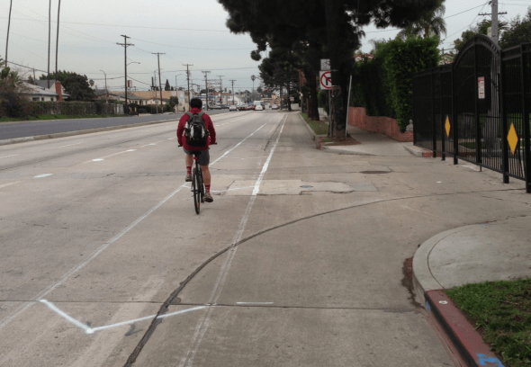 Existing eastbound bike lanes on Venice Boulevard (pictured here at Wellington Road) are being upgraded to buffered bike lanes.