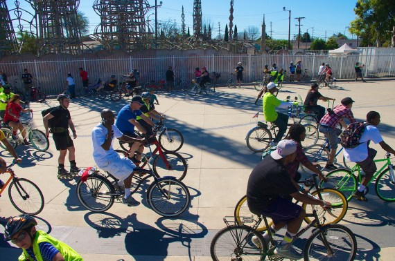 Riders circle the plaza at the Watts Towers. Sahra Sulaiman/Streetsblog L.A.