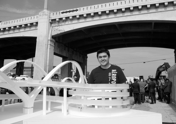 Roosevelt High School student Angel Rodriguez stands next to the section of the model he helped the architects at Michael Maltzan build. Sahra Sulaiman/Streetsblog L.A.